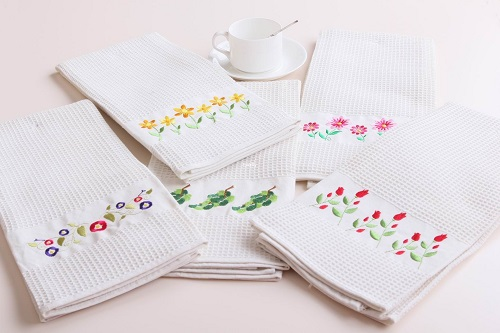 Five Designed Dish Towels on Table