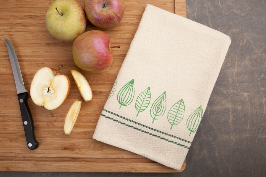 Leaf Stamped Kitchen Towel on Table with Sliced Apple