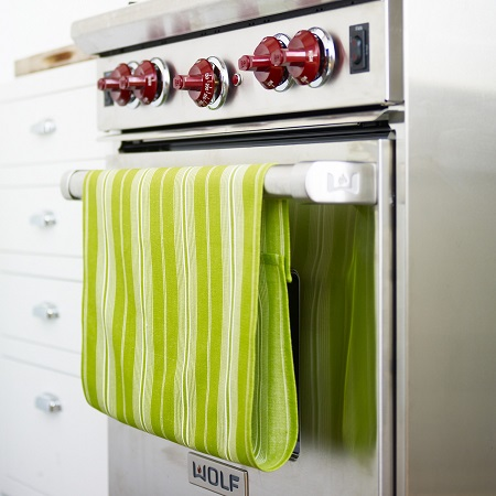 Green Kitchen Towel Hanging on Stove